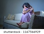 young sad and depressed asian... | Shutterstock . vector #1167566929