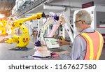 industry 4.0 robot concept ... | Shutterstock . vector #1167627580