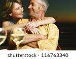 relaxed couple sitting enjoying ... | Shutterstock . vector #116763340