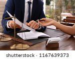 lawyer working with client at... | Shutterstock . vector #1167639373