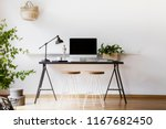 two hairpin stools placed by... | Shutterstock . vector #1167682450