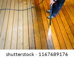 cleaning terrace with a power... | Shutterstock . vector #1167689176