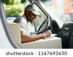 courier. delivery man reading... | Shutterstock . vector #1167692650