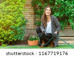 smiling young woman with garden ... | Shutterstock . vector #1167719176