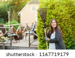 smiling young woman with garden ... | Shutterstock . vector #1167719179