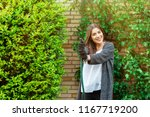 smiling young woman with garden ... | Shutterstock . vector #1167719200