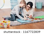 mother and autistic boy drawing ... | Shutterstock . vector #1167722839
