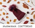 warm woolen cap placed with ... | Shutterstock . vector #1167738163