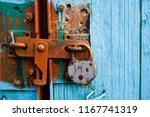 blue gates closed on a rusty... | Shutterstock . vector #1167741319