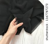 details of a black romper on a... | Shutterstock . vector #1167787273