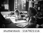 teacher interacting with... | Shutterstock . vector #1167821116