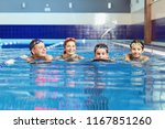 a happy family is smiling in a... | Shutterstock . vector #1167851260