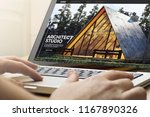 man using a laptop with... | Shutterstock . vector #1167890326