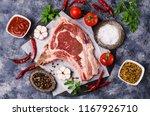 raw meat with bones on a dark... | Shutterstock . vector #1167926710