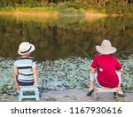 two little boys fishing on the... | Shutterstock . vector #1167930616