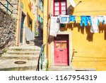 colorful houses in a narrow... | Shutterstock . vector #1167954319