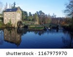 water mill near the city from... | Shutterstock . vector #1167975970