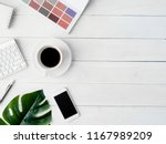 top view of office desk table... | Shutterstock . vector #1167989209