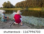 two little boys fishing on the... | Shutterstock . vector #1167996703