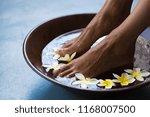 Woman Soaking Feet In Bowl Of...