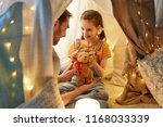family  hygge and people... | Shutterstock . vector #1168033339