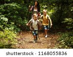 mother and her little sons... | Shutterstock . vector #1168055836