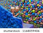 two happy kids have fun... | Shutterstock . vector #1168059406