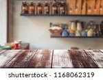 wood table on blur background... | Shutterstock . vector #1168062319