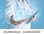 doctor shows numbers 2019 . the ... | Shutterstock . vector #1168103353