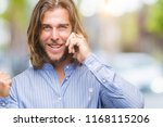 young handsome man with long... | Shutterstock . vector #1168115206
