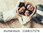 happy family lying of floor... | Shutterstock . vector #1168117276