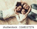 happy family lying of floor... | Shutterstock . vector #1168117276