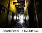 Stock photo dark corridor in the old kilmainham gaol 1168135663