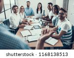 young smiling business people... | Shutterstock . vector #1168138513