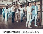 group of young business people... | Shutterstock . vector #1168138579