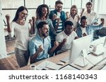 young smiling business team...   Shutterstock . vector #1168140343