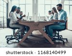 young smiling business people...   Shutterstock . vector #1168140499