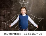 cute little schoolgirl against... | Shutterstock . vector #1168167406