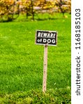 beware of dog sign posted in... | Shutterstock . vector #1168185103