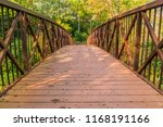 a well travelled wooden bridge... | Shutterstock . vector #1168191166