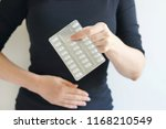 woman's hand touching her belly ... | Shutterstock . vector #1168210549