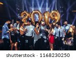 group of friends celebrating... | Shutterstock . vector #1168230250