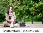 beautiful woman reading text...   Shutterstock . vector #1168242139