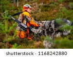 hunter and hunting dogs chasing ... | Shutterstock . vector #1168242880