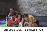 group of sportswomen stretching ...   Shutterstock . vector #1168266406