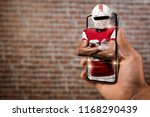 football player with a red... | Shutterstock . vector #1168290439