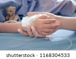 mother holding child's hand who ... | Shutterstock . vector #1168304533