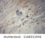 dirty black engine oil stain on ... | Shutterstock . vector #1168311046