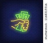 hand holding dollar bills neon... | Shutterstock .eps vector #1168315516