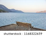 the settle on the pier in the...   Shutterstock . vector #1168322659